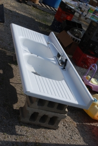 If I said this garage sale had everything but the kitchen sink, I'd be lying...