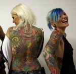 People show off their tattoos during tattoo expo in Budapest