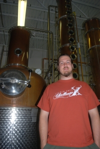 Landis and his stills.  Pot still left; column still right.