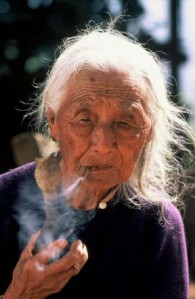 Mrs. Kurniawan has been reduced to smoking old stogies she has found.  Fat, but not too big around.