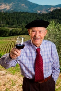 Mike Grgich holding a glass of something you can't pronounce.