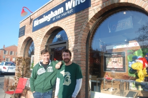 Ed Bosse (l) and Andrew Sjolander (r) in front of the store on the day of Big 10 Championship game